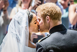 Meghan Markle and Prince Harry kiss on the steps of St George's Chapel at Windsor Castle following their wedding.