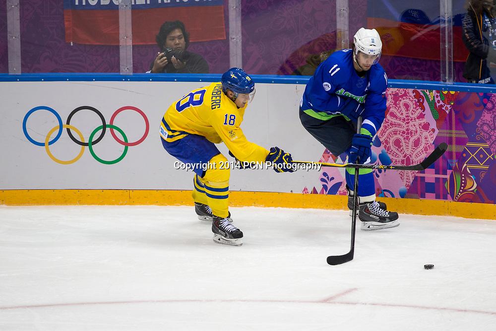 Jakob Silfverberg (SWE)-18, Anze Kopitar (SLO)-11 during Sweden vs Slovenia game at the Olympic Winter Games, Sochi 2014
