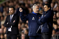 Sunderland manager Chris Coleman (right) listens to assistant manager Kit Symons during the Sky Bet Championship match at Craven Cottage, London.