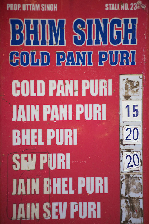 A sign on a food stall at CHowpati beach selling cold pani puri and other delicacies.