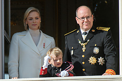 Princess Charlene and Prince Albert II of Monaco and little Prince Jacques are attending on the balcony during the National Day ceremonies, Monaco Ville (Principality of Monaco), on November 19th, 2019. Photo by Marco Piovanotto/ABACAPRESS.COM