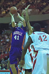 09 January 2010: Pieter Van Tongeren slaps a hook shot over the defending arms of Jackie Carmichael. The Purple Aces of Evansville play the Redbirds of Illinois State on Doug Collins Court inside Redbird Arena at Normal Illinois.
