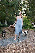 Jessi with her Kunekune cross pet pigs