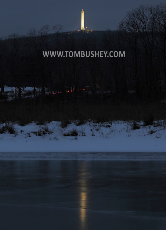 Wantage, New Jersey - The monument at High Point State Park is reflected in a frozen pond on  Dec. 31, 2010. The monument is located on the highest elevation in the state at 1,803 feet. The 220-foot tower was built in 1930 to commemorate the war dead.