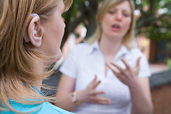 Women using sign language at The Nottinghamshire Deaf Society,