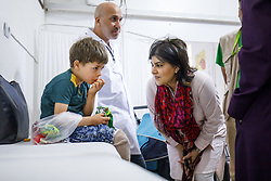 May 27, 2017 - London, London, UK - London, UK. Former Minister of State for Faith and Communities, BARONESS WARSI meets a Syrian boy who lost both of his legs and two siblings during a rocket strike at a visit to a prosthetic centre on the Turkish-Syrian border, which helps Syrian refugees who lost their limbs during the conflict, near Reyhanlõ, Turkey on the first day of Ramadan. The clinic is funded by UK based charity Muslim Aid. (Credit Image: © Tolga Akmen/London News Pictures via ZUMA Wire)