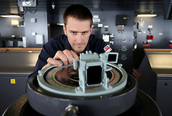 Lieutenant Commander and Navigator Jeremy Brettell makes final preparations on the bridge ahead of sea trials this summer, for the Royal Navy's new aircraft carrier HMS Queen Elizabeth, at Rosyth Dockyard in Dunfermline.
