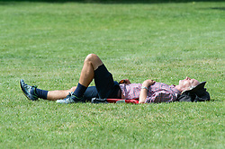 © Licensed to London News Pictures 15/06/2021. Greenwich, UK. A man sunbathing in Greenwich park. People out and about in Greenwich, London today enjoying the warm weather. Photo credit:Grant Falvey/LNP