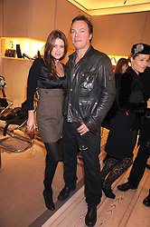 PETE & CAROLINA TONG at a party at Roger Vivier, Sloane Street, London on 2nd December 2008.