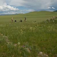 A Smithsonian Museum archaeology team studies a 2700+ year-old khirigsur burial mound at Ulaan Tolgoi, near Lake Erkhel & Muren, Mongolia.