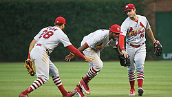 July 21, 2017 - Chicago, IL, USA - St. Louis Cardinals center fielder Dexter Fowler, middle, is congratulated by teammates after an 11-4 win against the Chicago Cubs on Friday, July 21, 2017, at Wrigley Field in Chicago. (Credit Image: © John J. Kim/TNS via ZUMA Wire)
