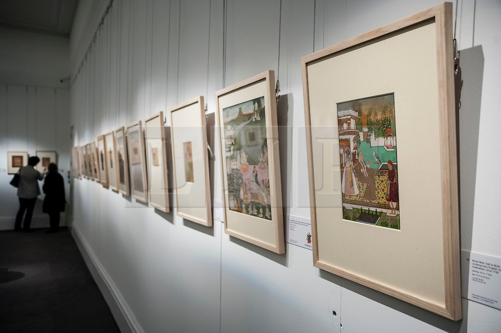 """© Licensed to London News Pictures. 02/10/2015. London, UK. Examples from the Sven Gahlin Collection of 157 finely painted Indian miniature paintings at the preview of Indian and Islamic Art Week at Sotheby's which runs from 2 to 7 October.   The far right painting is """"The emperor Bahadur Shah I enthroned, attributable to Bhavanidas, Mughal, circa 1707"""" (est. £60k - 80k).   Photo credit : Stephen Chung/LNP"""