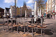 Coronavirus / Covid 19 outbreak, April 7th. 2020. Stacked chairs an tables of a closed restaurant at the Alter Markt in the old town, Cologne, Germany<br /> <br /> Coronavirus / Covid 19 Krise, 7. April 2020.Gestapelte Stuehle und Tische eines geschlossenen Restaurants am Alter Markt in der Altstadt,  Koeln, Deutschland.