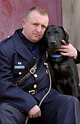 4/8/04 2RobMajor<br /> ML0122E<br /> New Haven Police Officer Robert Fumiatti and his drug dog Major after their graduation from the State Police Canine Training Unit in Meriden. Photo by Mara Lavitt