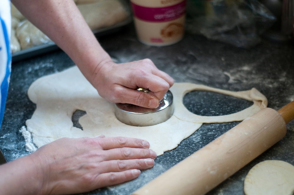 The dough is rolled out and then bits are punched or cut out.