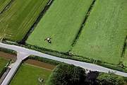Nederland, Zuid-Holland, Groene Hart, 12-05-2009; Polder Nieuwkoop, traktor is vers gemaaid gras aan het keren zodat het verder kan drogen in de zon..Swart collectie, luchtfoto (toeslag); Swart Collection, aerial photo (additional fee required).foto Siebe Swart / photo Siebe Swart