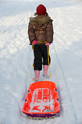© under license to London News Pictures.  19/12/2010 A child pulls a sledge through the freshly fallen snow in Worcestershire today (19/12/2010). Snow has fallen over much of the UK in the past few days. (Parental permission granted for photograph) Picture credit should read: David Hedges/LNP
