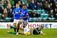 Alfredo Morelos (#20) of Rangers evades the sliding challenge of Ryan Porteous (#36) of Hibernian during the Ladbrokes Scottish Premiership match between Hibernian and Rangers at Easter Road, Edinburgh, Scotland on 19 December 2018.