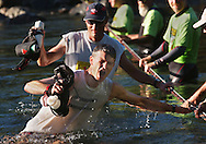Joe Kulak <cq>, from Colorado,  gets a jolt from dunking his head as he crossed the Middle Fork of the American River during the Western States 100 mile Endurance Run Saturday, June 28, 2003.  He would go on to finish 6th in the rce.   It was the 30th annual ultra-marathon run from Squaw Valley to Auburn, CA. At mile 78, the Rucky Chucky aid and medical station is setup to assess all runner's condition and to provide food and fluid replenishment before the athletes cross the Middle Fork of the American River.