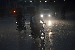 June 20, 2017 - Lahore, Punjab, Pakistan - A view of the heavy monsoon rain fall in Lahore weather became pleasant when dark clouds covered the sky and cool breeze start blowing followed by heavy showers in Provincial Capital Lahore on June 19, 2017.The city received the first heavy monsoon rain coupled with a windstorm on today ''Heat-stricken residents of Lahore received respite from the sweltering heat as the rain of  monsoon season turned the weather pleasant. (Credit Image: © Rana Sajid Hussain/Pacific Press via ZUMA Wire)