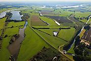 Nederland, Gelderland, Gemeente Voorst, 03-10-2010; De Voorster Klei, gezien naar het zuiden, Zutphen aan de verre horizon. In het kader van het programma Ruimte voor de Rivier zal in het gebied een dijkverlegging plaats vinden. Het eerste deel van de bestaande dijk (links) wordt verlaagd en er komt een nieuwe dijk meer landinwaarts. De nieuwe dijk begint rechtsonder (links van het gemaal) en loopt naar het zuidoosten. Sommige huizen moeten waarschijnlijk worden geamoveerd..Voorster 'clay' seen to the south, Zutphen on the distant horizon. A new dike will be built, more inland straiten bottom right. The first part of the existing dike (left) will be partially reduced in height, creating 'more spacee for the river'. .luchtfoto (toeslag), aerial photo (additional fee required).foto/photo Siebe Swart