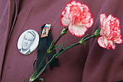 Moscow, Russia, 24/04/2007..The body of former Russian President Boris Yeltsin lies in state in the Cathedral of Christ the Saviour as mourners visit to pay their last respects. A mourner carrying flowers and wearing Yeltsin badges.