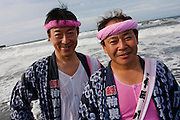 Portrait of a mikoshi supporters during the Hamaorisai Matsuri that takes place on Southern Beach in Chigasaki, near Tokyo, Kanagawa, Japan Monday July 18th 2011. The festivals marks the celebration of Marine Day and the rescuing of a divine image that was washed ashore in the area. Over thirty Mikoshi or portable shrines are carried through the night from surrounding shrines to arrive on the beach for sunrise. There they are blessed and then carried into the surf to purify them.