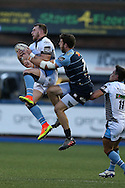 Stuart Hogg of Glasgow Warriors jumps for a high ball with Alex Cuthbert of the Cardiff Blues.  Guinness Pro12 rugby match, Cardiff Blues v Glasgow Warriors Rugby at the Cardiff Arms Park in Cardiff, South Wales on Friday 16th September 2016.<br /> pic by Andrew Orchard, Andrew Orchard sports photography.