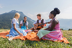 Teenage friends enjoying with guitar during picnic, Bavaria, Germany