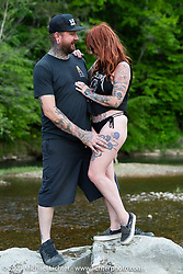 Savannah Rose and Chris Moos chillin' at the stream at the Tennessee Motorcycles and Music Revival at Loretta Lynn's Ranch. Hurricane Mills, TN, USA. Friday, May 21, 2021. Photography ©2021 Michael Lichter.