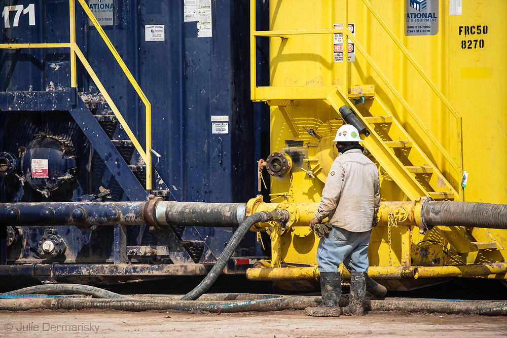 Worker at a fracking industry site in the Permain Basin.