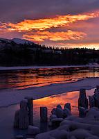 A fiery winter sunrise along the Yukon River
