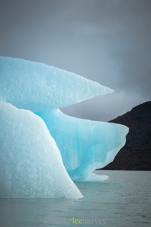 Iceberg on lake Lago Grey on cold winter day, Torres del Paine National Park, Chile