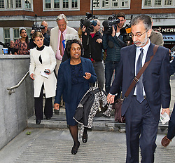 """© London News Pictures. 27/06/2013. London, UK. DOREEN LAWRENCE (centre), mother of murdered teenager Stephen Lawrence, arriving at the Home Office in London where she is due to meet with Home Secretary Theresa May for talks amid claims police tried to """"smear"""" the family in the wake of his 1993 murder. Photo credit: Ben Cawthra/LNP"""