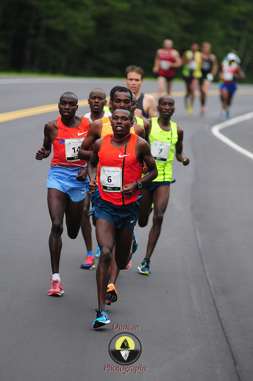 SOUTH PORTLAND, Maine -- 8/2/14<br /> <br /> Bib #        6   <br /> Runner Name: Karoki Muchiri<br /> <br /> The Beach to Beacon, a 10k road race through the streets of Cape Elizabeth and South Portland Maine, brought world class athletes together with more than 2000 runners from all over the world. Weather was humid and grey, but the rain mostly held off through the day.  Photo  ©2014 by Roger S. Duncan