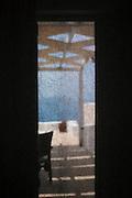 Window screen towards a balcony terrace in a hotel room, Santorini, Greece