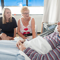 Nurse talking with patient and partner
