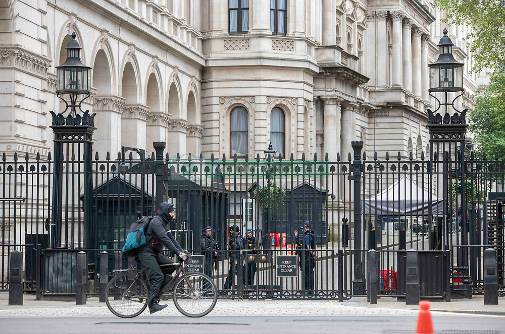 Man cycling in front of Downing Street, London, UK on April, 2020. Photo by Erica Dezonne/ABACAPRESS.COM