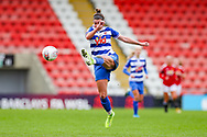 Reading defender Deanna Cooper (14) clears the ball during the FA Women's Super League match between Manchester United Women and Reading LFC at Leigh Sports Village, Leigh, United Kingdom on 7 February 2021.