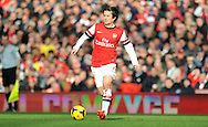 Arsenal's  Tomas Rosicky makes a break during the Barclays Premier League , Arsenal v Sunderland match at the Emirates Stadium in London, England on Saturday 22nd Feb 2014.<br /> pic by John Fletcher, Andrew Orchard sports photography.