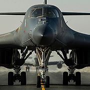 A 9th Expeditionary Bomb Squadron B-1B Lancer taxis down the runway, Oct 23, 2014, at Al Udied Air Base, Qatar. the B-1B crew will deploy the AGM-158 Joint Air-to-Surface Standoff Missile (JASSM) for the first time in combat. The JASSM  is a stealthy guided missile. Designed to attack well-defended targets without putting its aircraft in danger of new long-range surface to air missile systems. (U.S. Air Force Photo by Staff Sgt. Perry Aston)
