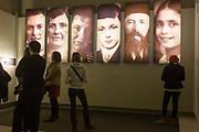 Visitors standing beneath panels with the faces of Jewish victims of the Holocaust, read the stories and history of Nazi anti-Semitism, in central Berlin, Germany. At first, these concentrations camps were meant to hold political prisoners; however, by the beginning of World War II, these concentration camps had transformed and expanded in order to house vast numbers of non-political prisoners whom the Nazis exploited through forced labor. Many concentration camp prisoners died from the horrible living conditions or from being literally worked to death. It is estimated that the Nazis used these camps to kill an estimated 11 million people.