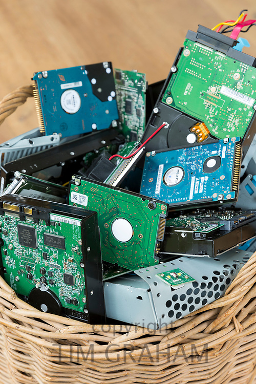 Circuit boards of computer hard drives, cables, connections and terminals in waste bin