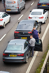 © Licensed to London News Pictures. 19/09/2017. HANSLOPE, UK.  General view of the closed southbound carriageway of the M1 near Hanslope between junctions 15 and 14. The road has been closed since 7:30am this morning, trapping hundreds of people, as the police deal with a suspicious item found under a bridge. The location is very near to Hanslope Park, home to Her Majesty's Government Communication Office (HMGCC0, part of FCO.  Photo credit: Cliff Hide/LNP