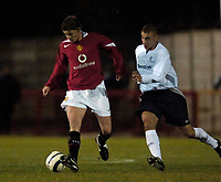 Photo: Jed Wee.<br /> Manchester United Reserves v Bolton Wanderers Reserves.<br /> 15/12/2005.<br /> <br /> Manchester United's Ole Gunnar Solskjaer (L) with Bolton's Johann Smith.