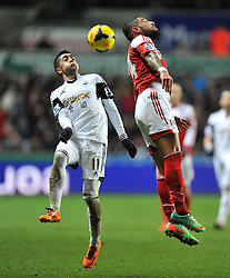 Fulham's Philippe Senderos wins a high ball from Swansea City's Pablo Hernandez - Photo mandatory by-line: Alex James/JMP - Tel: Mobile: 07966 386802 28/01/2014 - SPORT - FOOTBALL - Liberty Stadium - Swansea - Swansea City v Fulham - Barclays Premier League