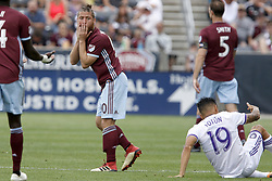 April 29, 2018 - Commerce City, Colorado - Colorado Rapids midfielder Enzo Martínez (90) reacts to getting a yellow card for his foul on Orlando City SC defender Yoshimar Yotún (19) in the second half of action in the MLS soccer game between Orlando City SC and the Colorado Rapids at Dick's Sporting Goods Park in Commerce City, Colorado (Credit Image: © Carl Auer via ZUMA Wire)