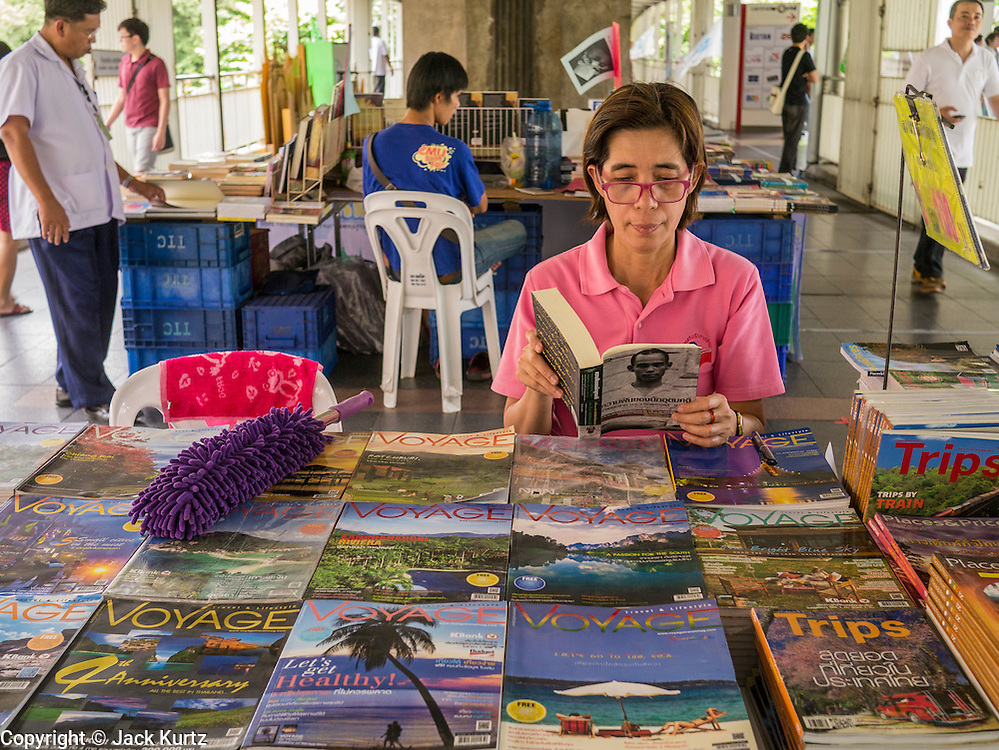 """23 APRIL 2013 - BANGKOK, THAILAND:   A book fair in the walkway of the Siam Skytrain station in Bangkok in honor of Bangkok being named the World Book Capital. UNESCO has awarded Bangkok the World Book Capital City 2013. Bangkok is the 13th city to assume the title of """"World Book Capital"""", taking over from Yerevan, Armenia. Bangkok Governor Suhumbhand Paribatra announced plans that the Bangkok Metropolitan Administration (BMA) intends to encourage reading among Thais. The BMA runs 37 public libraries in the city and has modernised 14 of them. It plans to build 10 more public libraries every year. Port Harcourt, Nigeria will be the next World Book Capital in 2014..PHOTO BY JACK KURTZ"""