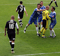 Photo: Paul Thomas.<br /> Oldham Athletic v Swansea City. Coca Cola League 1. 12/08/2006.<br /> <br /> Oldham congratulate goal keeper Chris Howarth (Yellow) after he saves Swansea's Lee Trundle's (10) penalty.