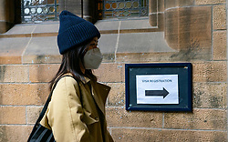 Glasgow, Scotland, UK. 25 September, 2020. Many students at Glasgow University have tested positive for the Covid-19 virus. The Scottish Government has controversially ordered students in several halls of residence where positive cases have spiked, to self-isolate indefinitely. Pictured; New Chinese student queuing to have visa and matriculation processed.  Iain Masterton/Alamy Live News